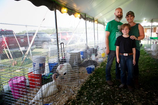 Kevin Gerth (left), Holly Gerth (right) and their son Russell Gerth pose for a portrait on Wednesday, July 10, 2019, at the Hamilton County 4-H Community Fair in Hamilton, Ohio. The family has turkeys at the fair.