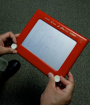 A man plays with an Etch-A-Sketch screen on March 22, 2012 in Washington, DC.
