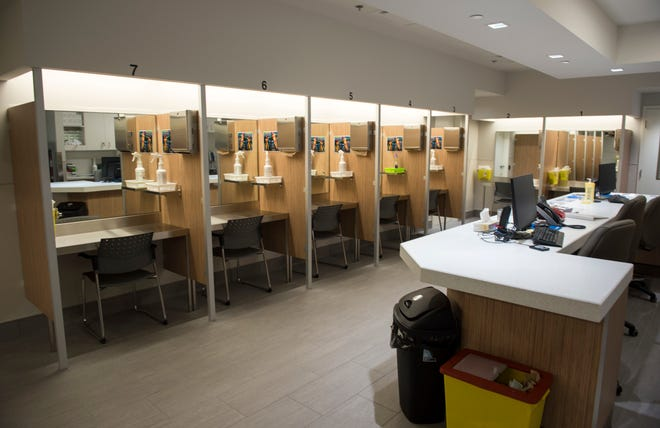 "In this June 26, 2017 photo, booths line the Cactus ""safe injection site,"" where drug addicts can shoot up using clean needles, get medical supervision and freedom from arrest, in Montreal. More than a dozen other potential sites are being considered across Canada federal officials say. (Paul Chiasson/The Canadian Press via AP)"
