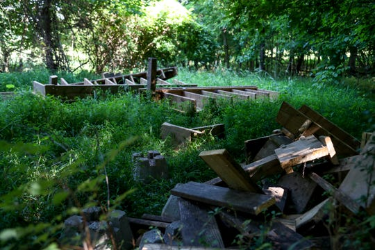 The remains of Hunter Belvin's Eagle Scout Project, a boardwalk serving an often flooded area of trail, sits tossed in a clearing near the trail at Dunbar Cave State Park in Clarksville, Tenn., on Thursday, July 11, 2019.