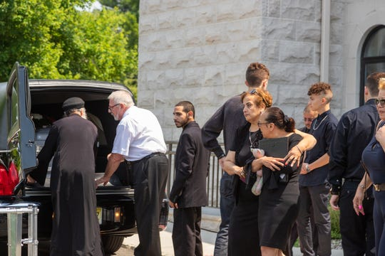 Family and friends mourn at the funeral for Sarah Aziz at the St. Mina Coptic Orthodox Church on Thursday.
