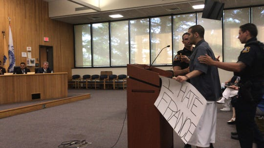 Edison resident Christo Makropoulos disrupts a July 10 township council meeting two days after four complaints were filed against him because of behavior outside another public meeting.