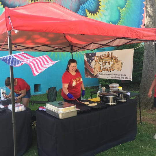 Lee Casey making quesadillas at a pop-up booth.