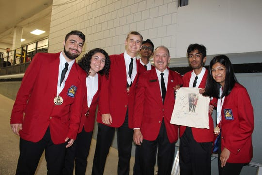 Members of the SCVTHS gold medal winning Quiz Bowl team (left to right) Omar Khasawneh of Somerset, Mona Marhaba of Bridgewater, Evan Sapirman of Hillsborough, Varun Punnam of Bridgewater, SkillsUSA Executive Director Timothy W. Lawrence, Quiz Bowl team members Abiram Gangavaram of Watchung and Rima Amin of Bridgewater pose for a photo after receiving their medals at the 55th Annual SkillsUSA National Leadership and Skills Conference.