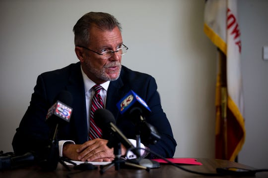 Michael Randol, Iowa Medicaid Director, answers questions from the press during a news conference following the state's agreement to 8.6% increases in pay to Amerigroup and Iowa Total Care, the two national insurers managing Iowa's Medicaid program, on Thursday, July 11, 2019, in Des Moines.
