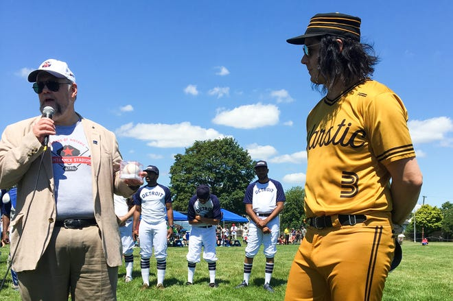 Jack White (right) listens as Gary Gillette speaks ahead of a charity baseball game in Hamtramck on July 11, 2019. Gillette is spearheading a campaign to restore Hamtramck Stadium, onetime home of the Negro League's Detroit Stars.