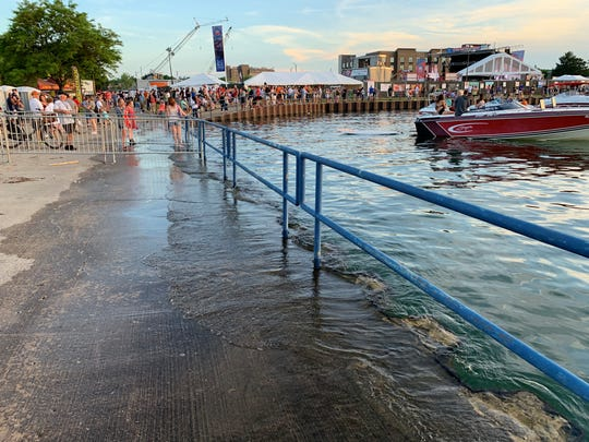 The high Lake Michigan water level reached the sidewalk during Traverse City's National Cherry Festival on July 3, 2019, along the Grand Traverse Bay.