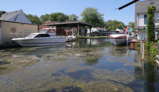 One of the canals in the Jefferson Chalmers neighborhood being flooded by the rising Detroit River Thursday, July 11, 2019 in Detroit, Mich.