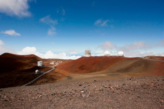 Observatories and telescopes sit atop Mauna Kea, Hawaii's tallest mountain and the proposed construction site for a new $1.4 billion telescope, near Hilo, Hawaii.