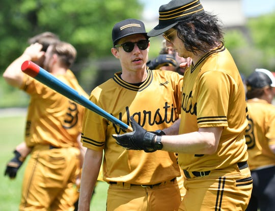 Jack White, right, prepares to bat.