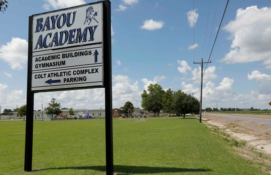 In this Friday, July 3, 2019 photo, grassy fields border Bayou Academy in Cleveland, Miss., one of two private schools that have a predominately white student body.