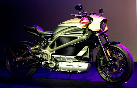 In this Jan. 7, 2019, file photo a Harley-Davidson Motorcycles LiveWire electric motorcycle is on display during a Panasonic news conference at CES International in Las Vegas. Harley Davidson is hoping to appeal to a younger demographic as it launches its first electric motorcycle.