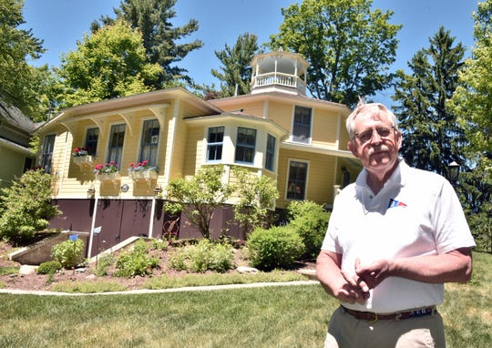 Don Duquette stands near his 1884 octagonal home Thursday, June 14, 2018 in the enclave of Bay View.
