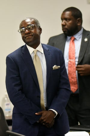 Khari Mosley, left, who is the husband of Allegheny County Controller Chelsa Wagner, stands during his trial in the courtroom of Judge Kenneth King, Thursday, July 11, 2019, at 36th District Court in Detroit.  At right is defense attorney Kevin Mincey.