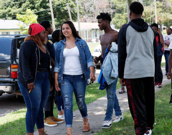 An integrated group of students leave Cleveland Central Middle School after finishing up their summer school studies for the day in Cleveland Miss.