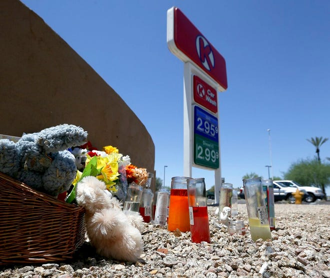 A makeshift memorial for Elijah Al-Amin is set up at a local Circle K store for the death of the stabbing victim Tuesday, July 9, 2019, in Peoria, Ariz. Peoria police arrested 27-year-old Michael Adams on suspicion of first-degree murder in the killing of 17-year-old Al-Amin, who was stabbed in his throat and back inside the store on July 4.
