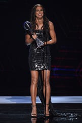 Alex Morgan accepts the award for best female athlete at the ESPY Awards on Wednesday.