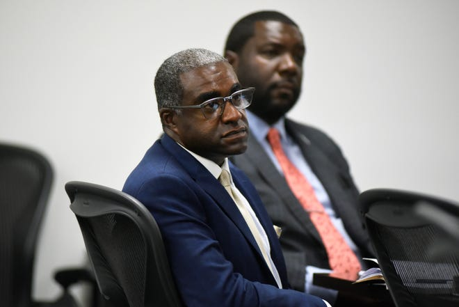 Khari Mosley, foreground, who is the husband of Allegheny County Controller Chelsa Wagner, sits during his trial in the courtroom of Judge Kenneth King, Thursday, July 11, 2019, at 36th District Court in Detroit.  Seated behind him is defense attorney Kevin Mincey.