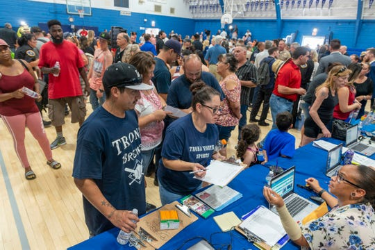Trona residents line up at the San Bernardino County's Transitional Assistance program on Wednesday July 10, 2019, in Trona, Calif., as the high school gym was converted into a local assistance center for recovery after a pair of earthquakes struck the unincorporated community.
