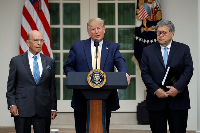 President Donald Trump is joined by Commerce Secretary Wilbur Ross and Attorney General William Barr, right, as he speaks in the Rose Garden at the White House in Washington, Thursday, July 11, 2019.