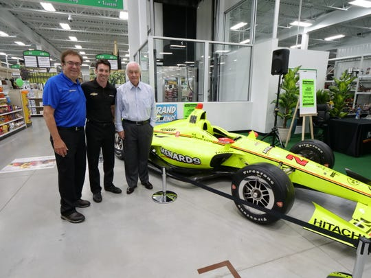 John Menard, Simon Pagenaud and Roger Penske at the Bloomfield Hills Menards grand opening on Wednesday.
