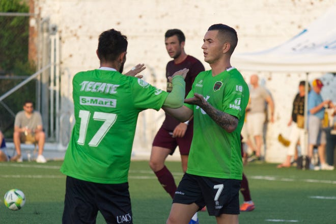 FC Juarez's Lucas Silva is congratulated by teammate Flavio Santos after Silva scored to make it 2-1 in favor of Los Bravos on Wednesday at Keyworth Stadium. Mexican first-division FC Juarez defeated Detroit City FC 3-1 in an international friendly before 6,901 fans.