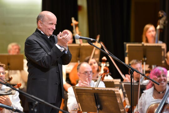 Maestro Stephen Gunzenhauser (shown) claps for a performance by a guest artist during a 2018 Endless Mountain Music Festival Symphony Orchestra concert. The maestro will be conducting the orchestra on three consecutive Friday and Saturday nights beginning Friday in Mansfield and ending on Aug. 3 in Corning.