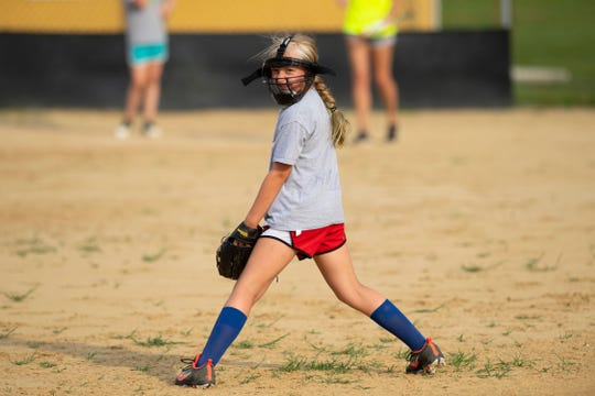 Brynn Gentry, 10, of Boonville, Ind., watches the ball roll out to center field during her Southern Stix softball practice at the Boonville softball fields Wednesday evening. The high temperatures and oppressive humidity had the girls practicing at about half-speed.