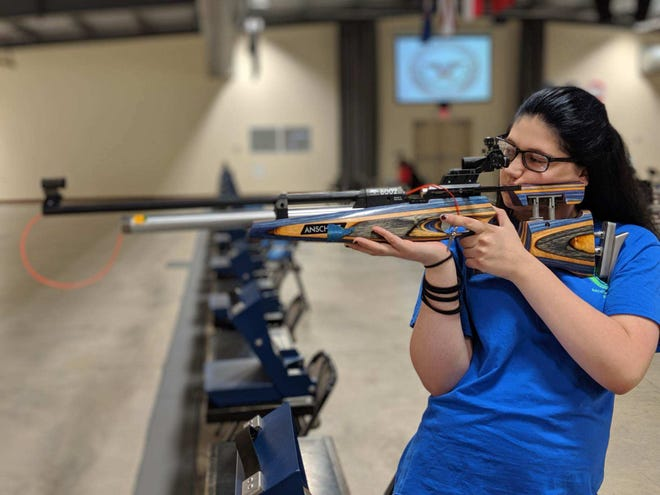 Tristian Roguski takes aim with her air rifle during a practice session at the Gary Anderson Competition Center at Camp Perry.