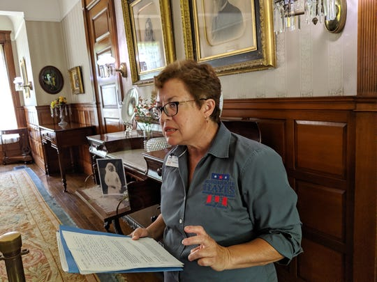 Tour guide Jean Blechschmidt leads media through the Hayes Home Museum dining room.