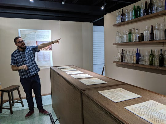 Kevin Moore, associate curator with the Hayes Presidential Museums, shows an exhibit he and volunteers built to show women's roles in Prohibition.