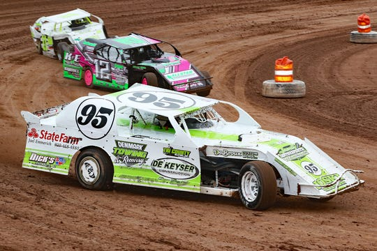 Former NASCAR star David Reutimann will wheel both an IMCA stock car and the sportmod normally driven by Sawyer Haese on July 20 during the Troy Rass Memorial Race.