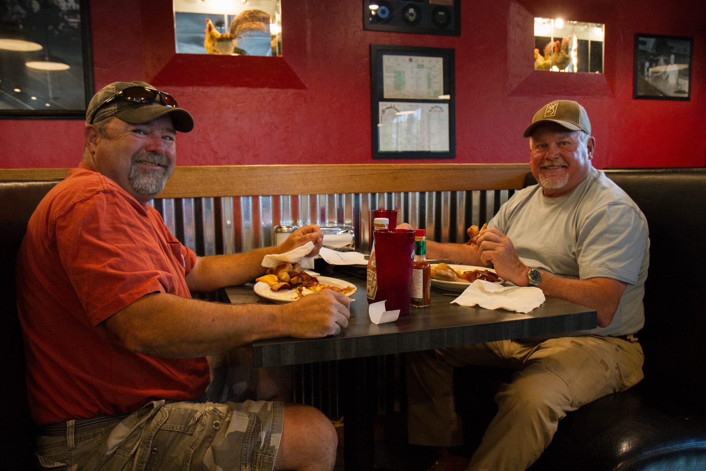 Greg Knorr and Brett Deschenes having breakfast at Tracy's on Thursday morning.