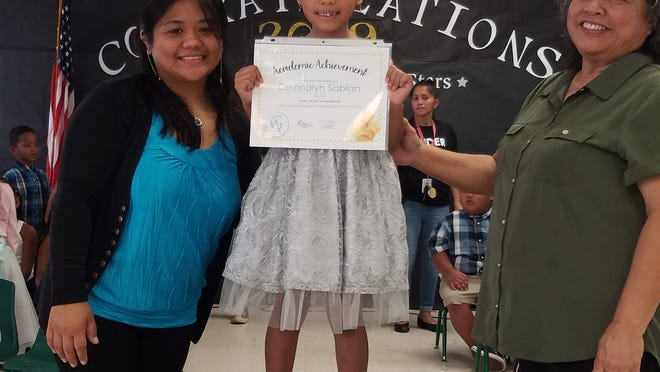 The Guahan Academy Charter School held its kindergarten promotional ceremony on May 22. Pictured from left: Robelyn  Bagaoisan; Derrinalyn Sablan and Mary Mafnas, dean of Elementary  School Guahan Academy Charter School.