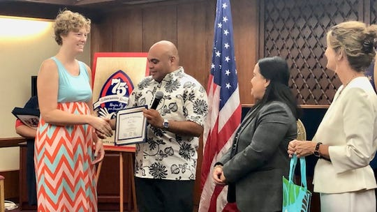 "Dr. Sara Ford, a volunteer veterinarian for the summer ""Spaycation"" program, receives a certification of appreciation from Acting Gov. Josh Tenorio, Speaker Tina Muna Barnes and Sen. Kelly Marsh on July 11, 2019 at Adelup."