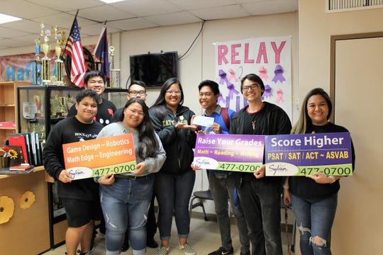 Sylvan Learning Center of Guam presented Tiyan High School with a donation for their participation in the 2019 Lip-Dub video contest on May 23. Pictured from left: Kole Balbas, Zuriel Ravela, Emmalayn Cruz, Paul Dumarao, Adia Cruz, Ronald Fuellas, Josiah Quitugua, Advisor Marianna Hernandez.