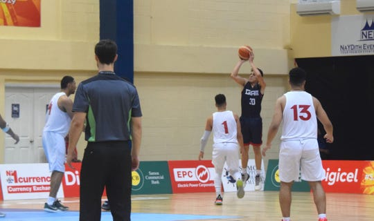 Takumi Simon shoots for one of his 30 points against Tonga at the Pacific Games in Samoa.