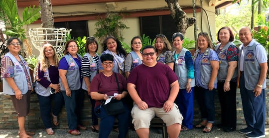 In its continuing service of caring for the sick and the elderly, the Guam Sunshine Lions Club made monetary donations to Jacob J.R. Mendiola, 7, of Harmon; and to Diana S. Pinaula, 68, of Agat, to assist with their medical treatment expenses on June 1 at the Chamorro Village.  Seated (left), Therese Pinaula (on behalf of her mother, Diana) and (right),  Marvin Blas (on behalf of son, Jacob).  Standing from left: Lions Dee Cruz, LouJean Borja, Flo Terlaje, Mary Taitano, Lorraine Rivera, Marie Salas, Clarice Quichocho, Marietta Camacho, Julie Cruz, Doris Cruz, and Pete Babauta.