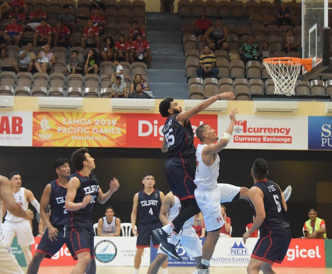 Jonathan Galloway goes for a block in the Guam men's team basketball against Tonga at the Pacific Games in Samoa.