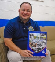 "Mayor Robert Hofmann displays a copy of the Guam Liberation 75 years commemorative hardcover book, ""A Legacy of Peace and Friendship,"" while at his office in Sinajana on Thursday, July 11, 2019."