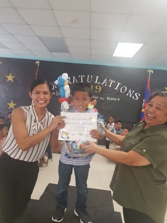 The Guahan Academy Charter School held its kindergarten promotional ceremony on May 22. Pictured from left: April Davis, Jessiah Taimanglo and Mary Mafnas, dean of Elementary  School Guahan Academy Charter School.