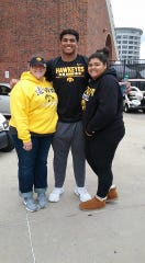Sarah, Tristan and Kaylia Wirfs pose outside Kinnick Stadium