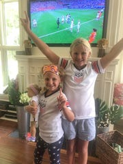 Arlie and Claire Sweigart are seen celebrating the USWNT World Cup win in their Alex Morgan jerseys. Both girls consider Morgan their favorite player.