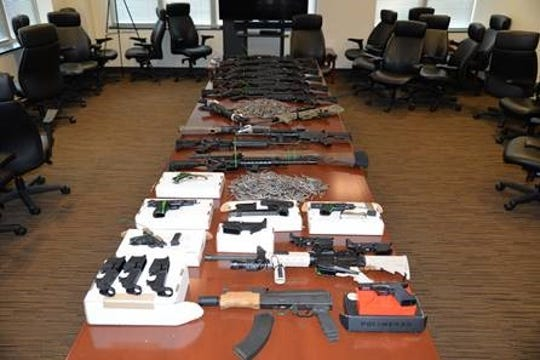 Federal officials say a pair of Fishers brothers manufactured weapons that they tried to sell overseas.