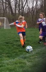 Rosie Levenshus is seen going to kick the ball. Her favorite player on the USWNT is Alex Morgan.