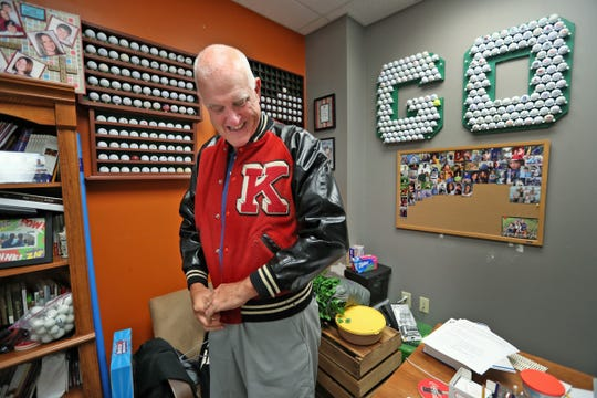 Brandywine Community Church Youth Pastor Troy Doubman shows some of his high school sports jerseys and his golf  ball collection in his office on July 8, 2019.