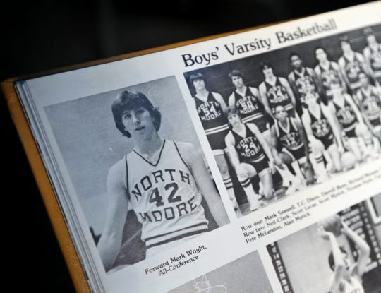 Brandywine Community Church Senior Pastor Mark Wright shows photos of his earlier athletic days, Monday, July 8, 2019.  Four pastors at the Greenfield church were athletes earlier in their lives.