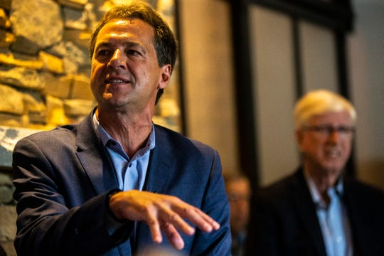 Montana Gov. Steve Bullock speaks during a meet and greet, Wednesday, July 10, 2019, at BlackStone in Iowa City, Iowa. Iowa Attorney General Tom Miller, at right.