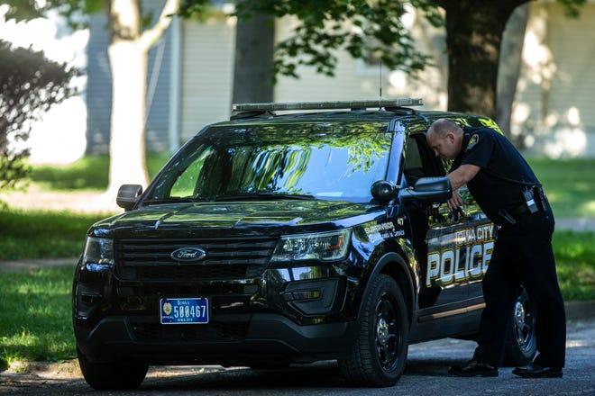 Iowa City police respond to a scene, Thursday, July 11, 2019, in the 800 block of East Fairchild Street in Iowa City, Iowa.