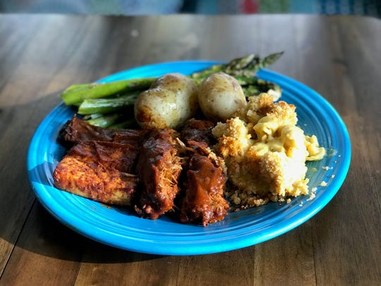 A Southern BBQ sampler plate with BBQ tofu, meatloaf, baked mac and cheese, salt potatoes, roasted veggies.
